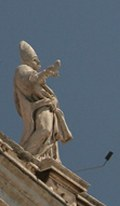 Papal statue plays air guitar